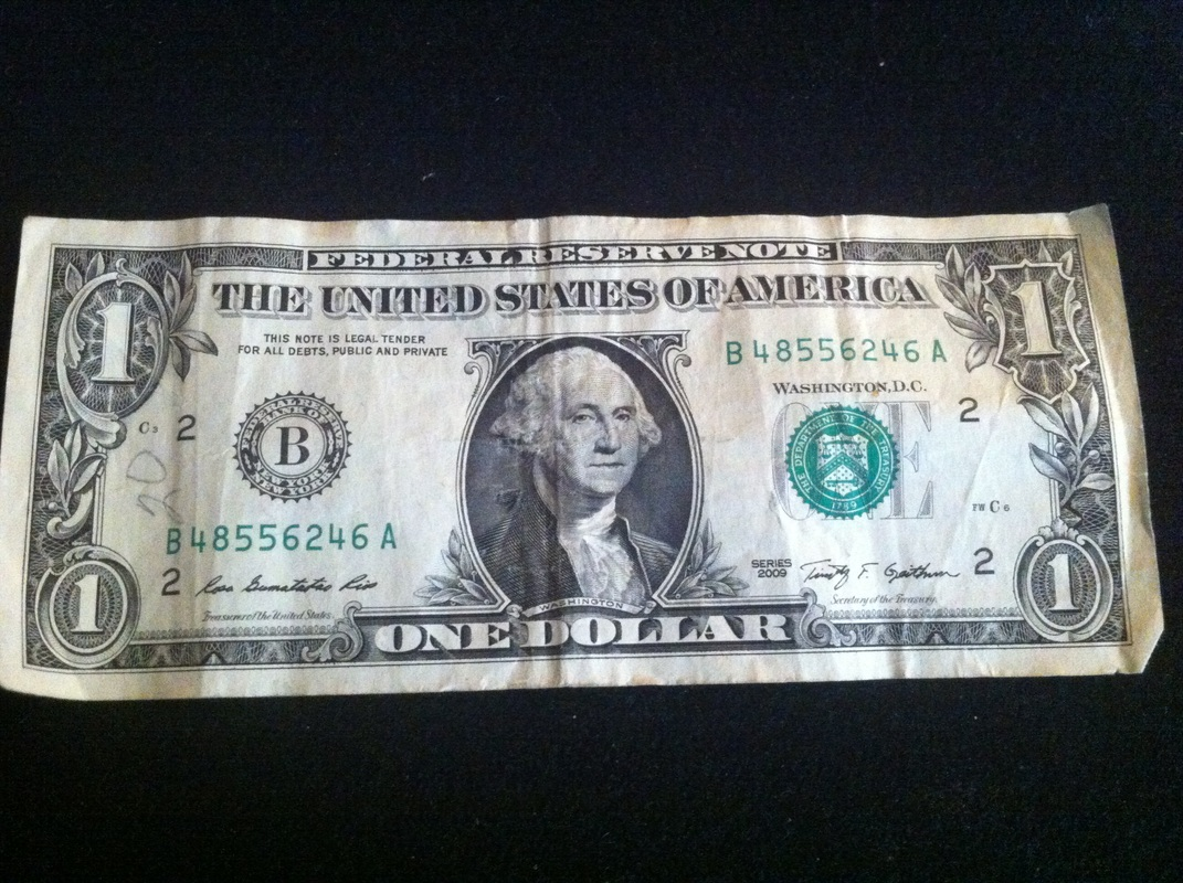 Picture of dollar bill unfolded.