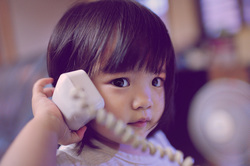Picture of child listening to phone