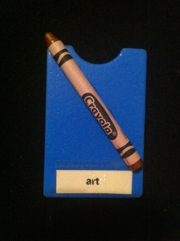 Art label with crayon glued to card