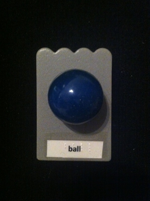 ball label with ball glued to card