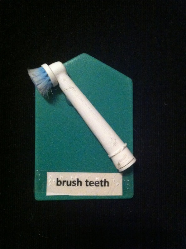 brush teeth label with top of toothbrush glued to card