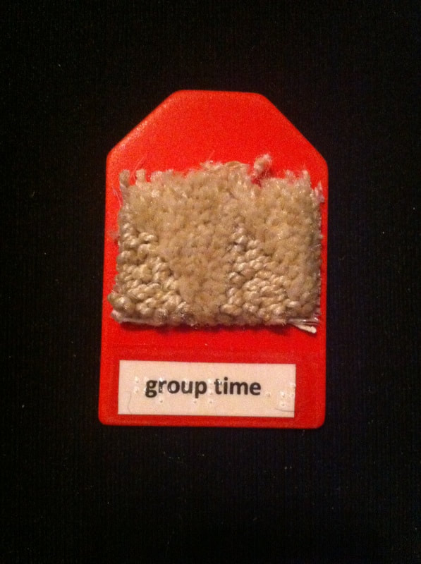 group time label with a piece of carpet glued to label