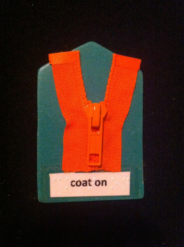 coat on label with zipper glued to card
