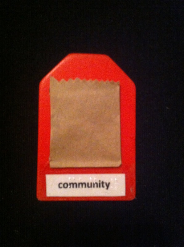 community label with the top of a grocery bag glued to card