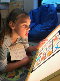 Picture of a student using a light box