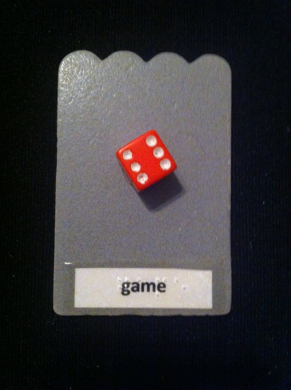 game label with dice glued to the card