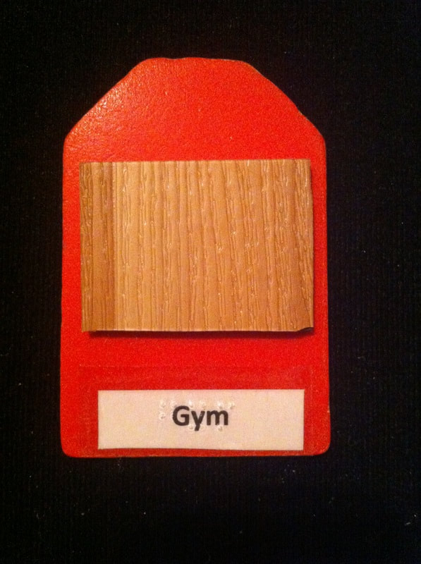 gym label with wood flooring glued to the card