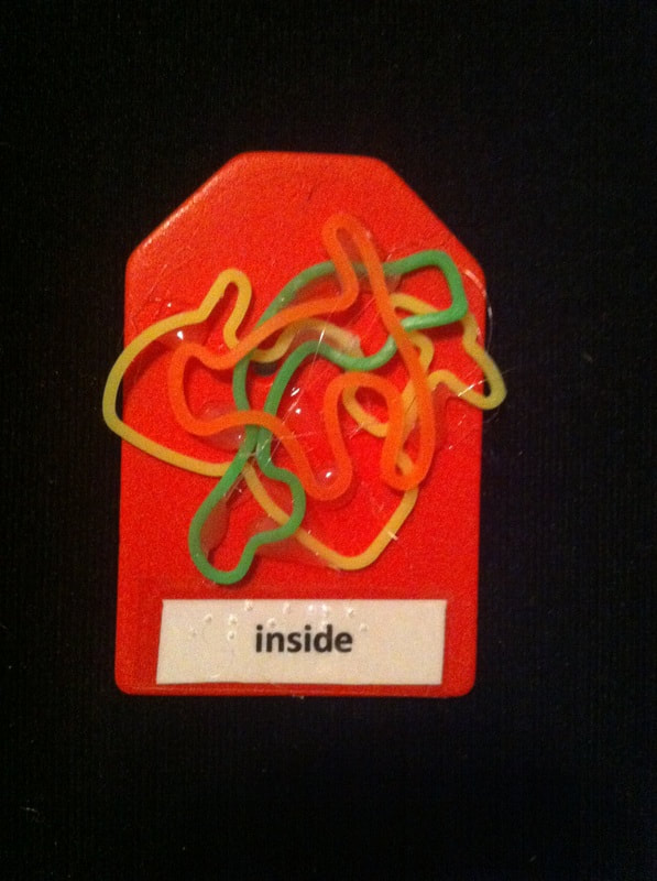 inside label with gummy bands glued to the card