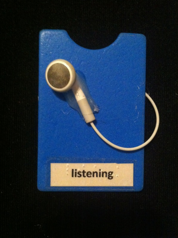 listening label with earbud glued to card