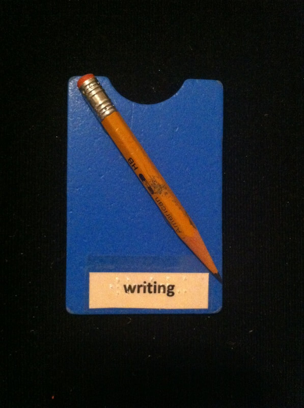 writing label with pencil glued to card